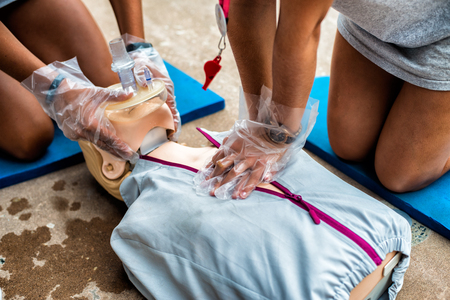 reanimate: Lifeguards making CPR on mannequin during training