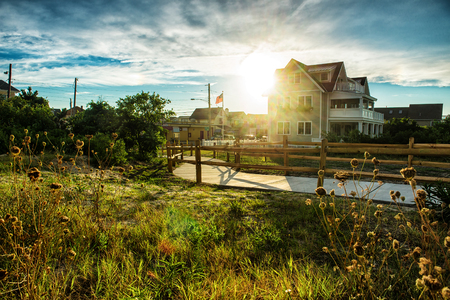 america countryside: Classical american house on small city with nature around at sunset time Stock Photo