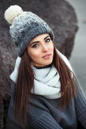 Portrait of beautiful winter woman wearing knitted winter clothes outdoors. Stock Photo