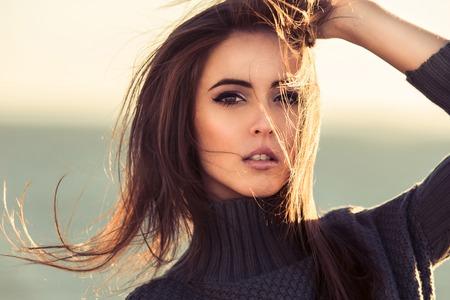 beauty eyes: Close-up portrait of beautiful brunette woman outdoors. Stock Photo