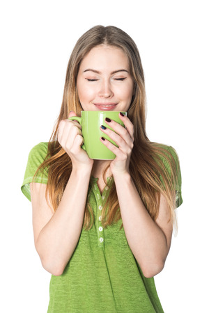 steam mouth: Beautiful woman enjoying cup of coffee isolated on white