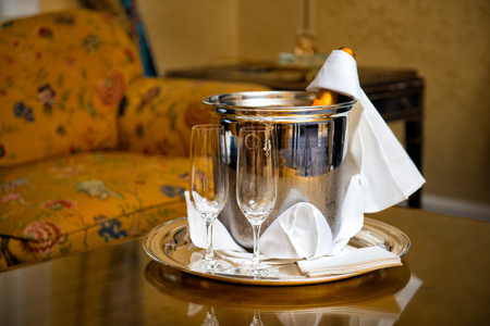 honeymoon suite: Luxury hotel room service with Champagne bottle and galasses