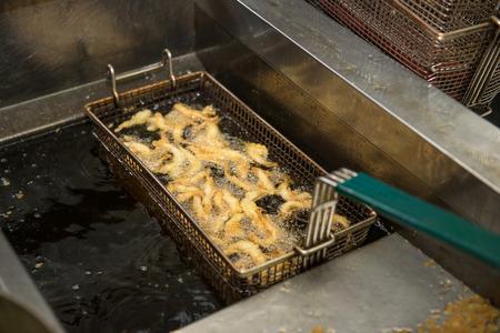 friture: shrimpins in breadcrumbs cooking on deep fryer