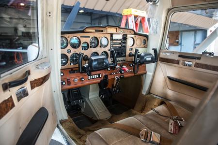 Small private plane pilot cabin with avionics equipment