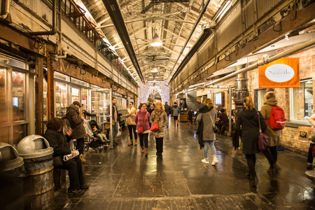 production facility: NEW YORK CITY - FEBRUARY 27: People on shopping at Chelsea Market. It is an enclosed urban food court, shopping mall, office building and television production facility on February 27, 2016 in New York City, USA Editorial