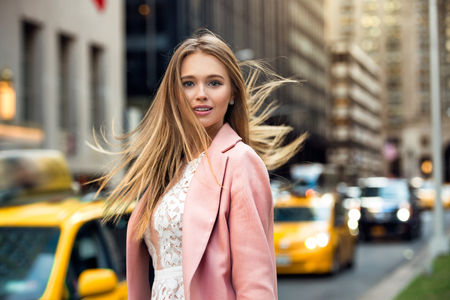 flyaway: Portrait of the blonde with flyaway hair in the background of New York City street with taxi cabs
