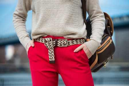 red cardigan: Fashionable women`s casual spring outfit with red pants, cardigan, modern belt and shoulder bag