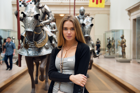 Beautiful woman visiting museum during vacation trip