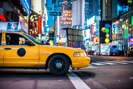 taxicabs: Yellow cabs in Manhattan, NYC. The taxicabs of New York City at night Time Square.