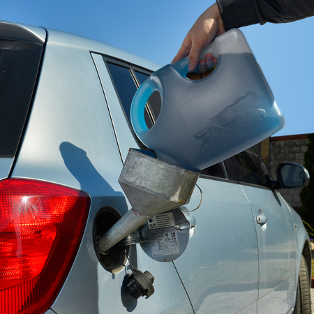 car gas: pouring fuel into the car gas tank