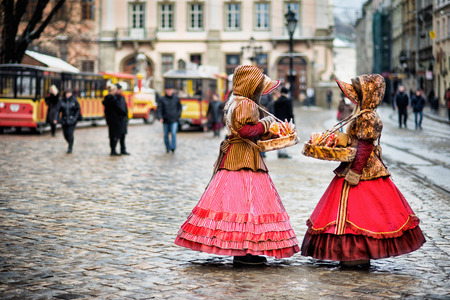croud: two woman in traditional clothes standing in the square in old city Lvov Stock Photo