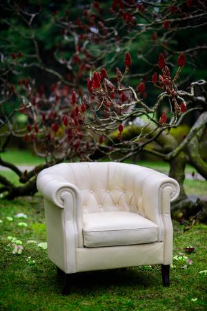 white sofa: White sofa in the garden Stock Photo