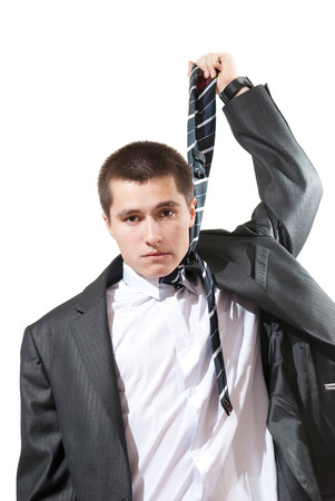 suffocation: Portrait of a young business man looking depressed from work isolated over white background