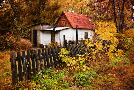 dwelling: a small house in the autumn forest in the village Stock Photo