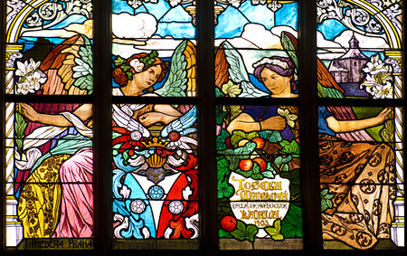 glasswork: stained glass window in old church two angel woman