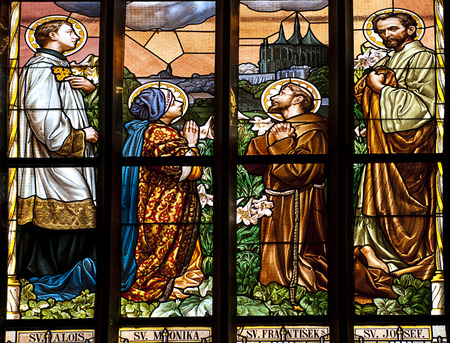 religious habit: stained glass window in old church with four saints person praying
