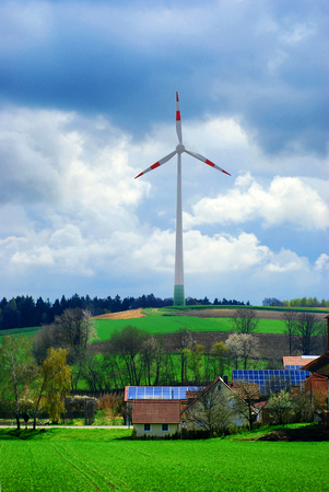 alternativ: solar energy panels at the countryside house and wind turbine in field