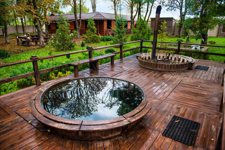 Sauna pool and jakuzzi with rest recreation area outdoor in luxury forest villa.