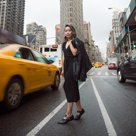 catching taxi: Asian woman catching a taxi in New York City street at rush time