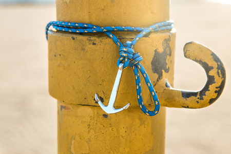Colorful silver anchor wristband with blue rope
