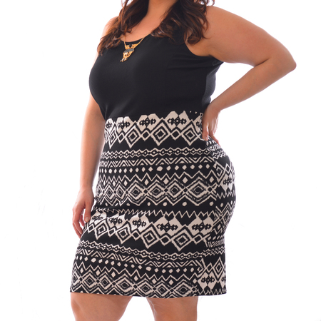 portrait of plus size model woman wearing XXL black t-shirt and skirt posing isolated on white background.