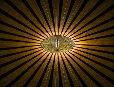 Golden all-seeing anonymous eye with lines and lights abstract religion background 写真素材