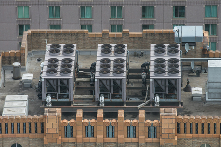 Air Conditioner ventilation system on building rooftop. Aerial view to AC system on skyscraper. 免版税图像