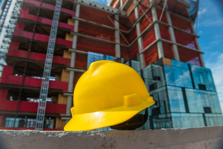 People on the construction and safety technic concept photo. Yellow helmet on the construction site. Stockfoto