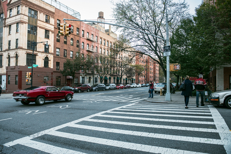 Manhattan uptown intersection with light, cars and crosswalk