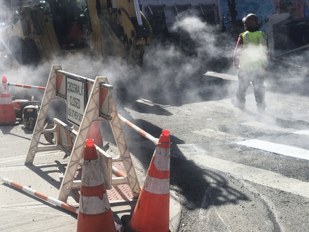 Asphalt and crosswalk line replacement roadworks on the city street