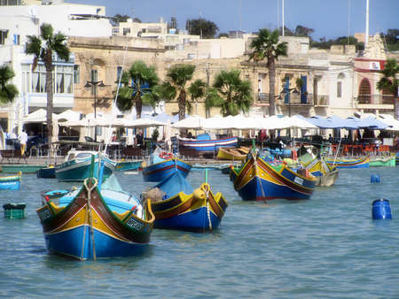 colorfull fishing boats in the bay, Marsaxlokk, Malta