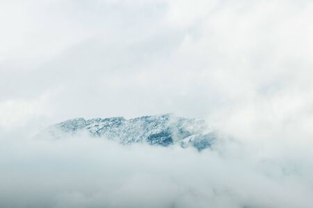 snow mountain covered in clouds at banff national park canada 免版税图像