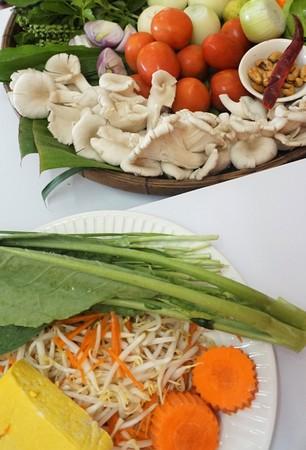 Basket of Thai foods for cooking, basil, garlic,cumin,lemon grass Stock Photo