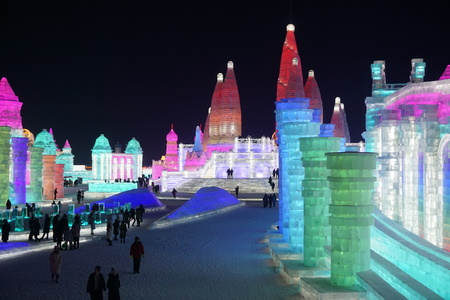Illuminated ice sculptures and buildings at the ice and snow festival in Harbin China