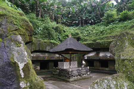 Balinese temple carved in stone with plants