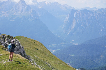 Great view of a hiker in the green valley in the alps Editorial
