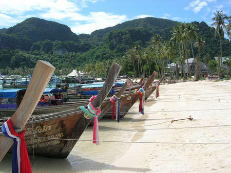 Touristboats on the beach at Phi Phi Don,Thailand photo
