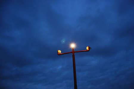 landing light: Irport landing light in the night. Bright light. Stock Photo