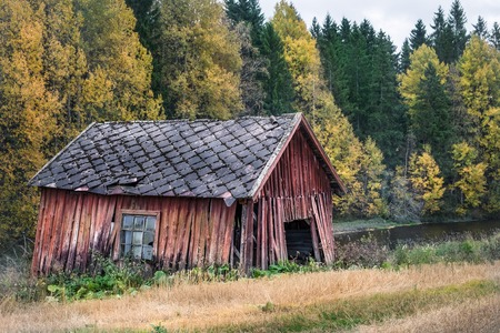 mirror frame: Abandoned shed with autumn colors at day time in Hyvinkaa, Finland Stock Photo
