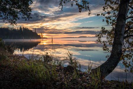 Idyllic landscape with sunset and lake at autumn morning Stock Photo