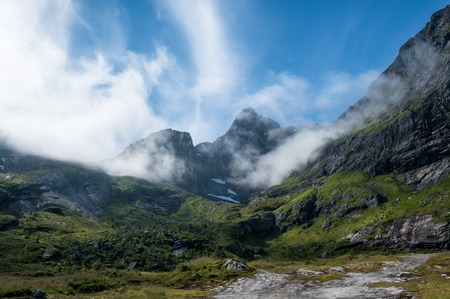 Scenic view from mountain peak at bright summer day in Lofoten, Norway