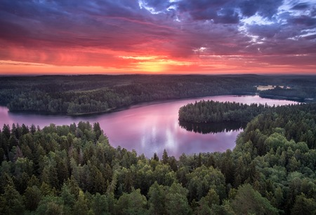surface: Scenic landscape with sunrise and lake at summer in national park Aulanko, Hmeenlinna, Finland