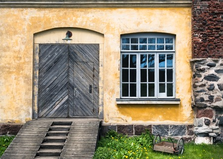 Some intresting views on old historical building with door and window in Suomenlinna (Sveaborg), Helsinki, Finland Stock Photo