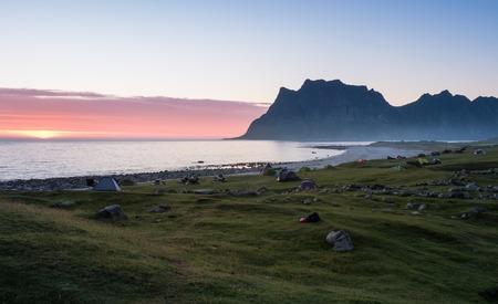 Scenic landscape with mountain and camping area at summer evening in Lofoten Island, Norway