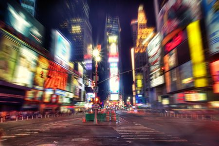 city square: Times Square, New York at night. Radial blur Stock Photo