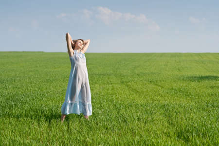 Young woman in nightdress on green meadow Stock Photo - 5019148