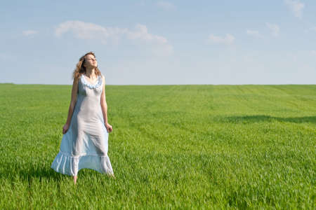 nightdress: Young woman in nightdress on green meadow Stock Photo