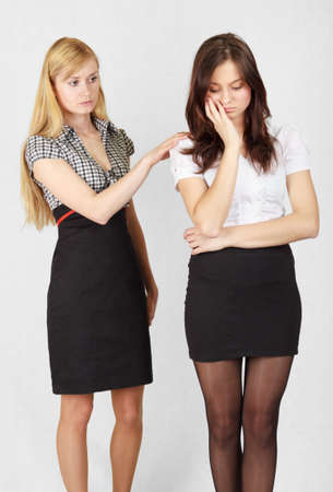Two female students  One student is comforting the another  Stock Photo - 13169914