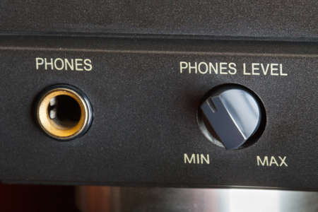 volume knob: Phones socket and volume knob on a hifi amplifier Stock Photo