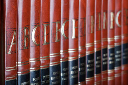 the encyclopedia: Row of encyclopedia books. Focus on volume A.